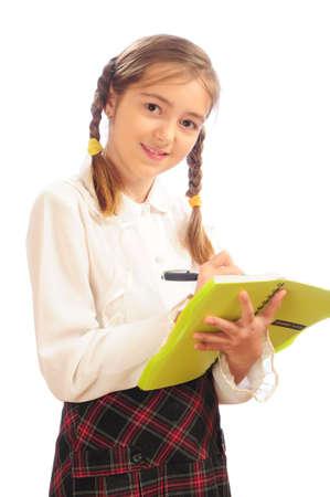 schoolgirl with copybook and pen Stock Photo - 4364269