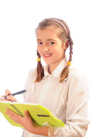 schoolgirl with copybook and pen