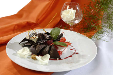 sweetness: chocolate dessert with a caramel, decorated white petals or rose and mint Stock Photo