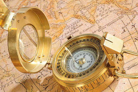 breadth: old-fashioned compass on a background an old map