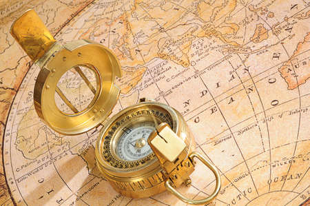 navigational light: old-fashioned compass on a background an old map
