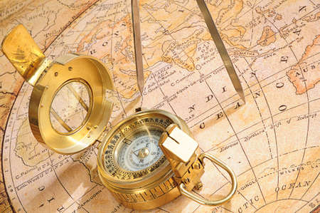 old-fashioned compass on a background an old map photo