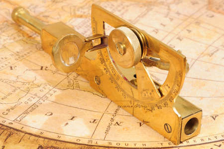 breadth: old-fashioned navigation device on a background an old map Stock Photo