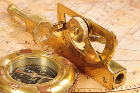 breadth: old-fashioned navigation devices on a background an old map