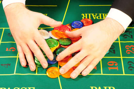 hands of the player collecting the chips won Stock Photo - 4471120
