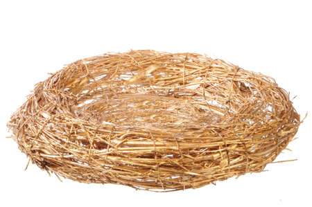 a straw: empty golden nest on white background Stock Photo