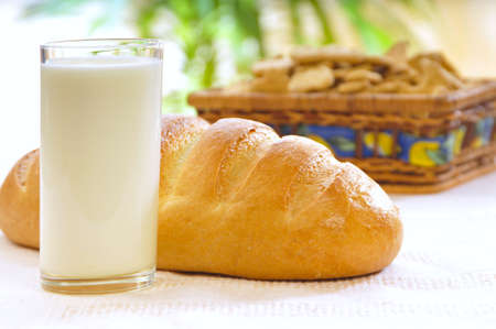 kefir: glass of milk or kefir with baton wheaten bread