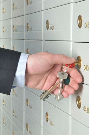 deposit slips: copula of the keys is in the hands of business man which opens the deposit safe in a bank Stock Photo