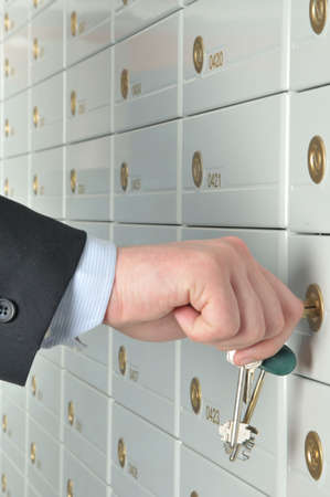 deposit slip: copula of the keys is in the hands of business man which opens the deposit safe in a bank Stock Photo