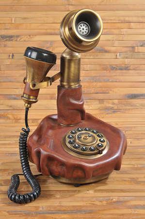 isolated old-fashioned phone on bamboo background photo