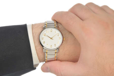 looking at watch: Business man looking at watch. Wristwatch on hand isolated on white.