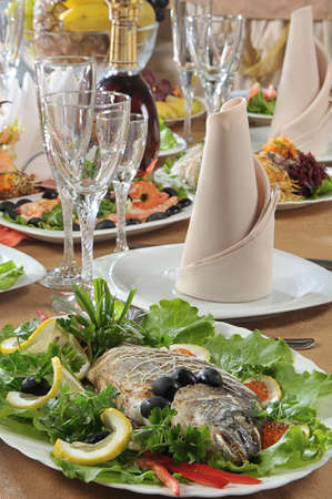 Table served in a restaurant with fish on a foreground Stock Photo - 6993959