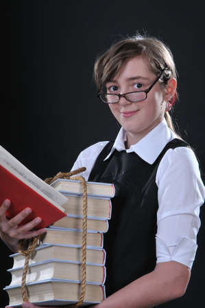 copula: the girl of twelve years gets on the hip the copula of books and opened red book