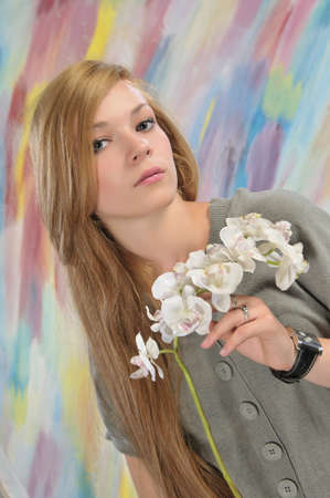 Portrait of long-haired beautiful girl 16-17 years with orchid Stock Photo - 7240669