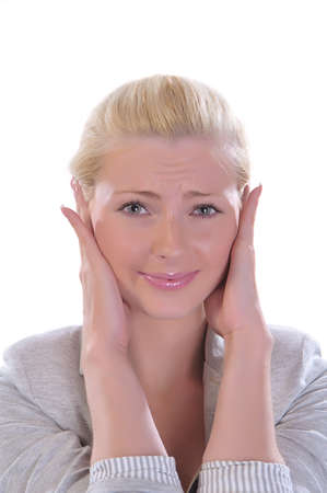 The blondy womanl closes ears hands Stock Photo