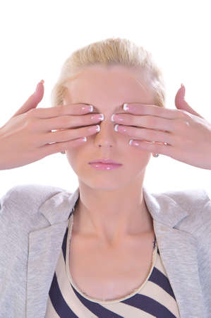 The blondy girl closes eyes hands photo