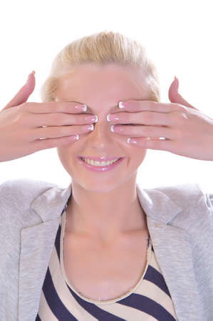The blondy woman closes eyes hands and smiles Stock Photo