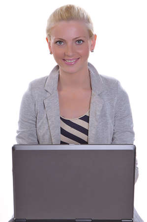 Beauty woman sits with a laptop Stock Photo