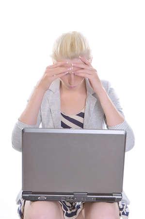Sad woman staring at her monitor.  photo