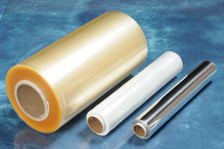 Rolls of film for vacuum packaging of foods and food foil
