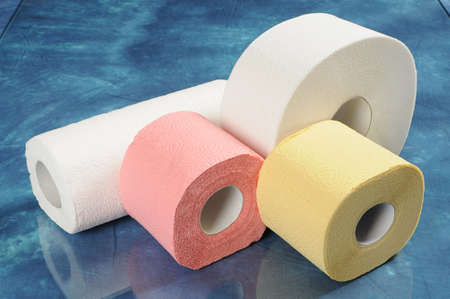 A set of rolls of toilet paper and paper towels with reflection Stock Photo