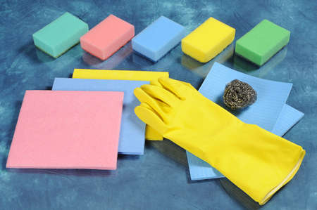 A set of cleaning tools, including kitchen sponges, absorbing cloths, household gloves, metal sponge