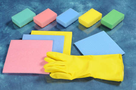 A set of cleaning tools, including kitchen sponges, absorbing cloths, household gloves