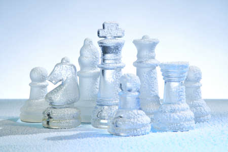 Glass chess figures, covered snow