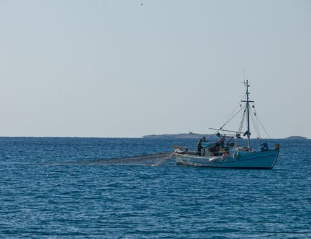 fishing at the aegean sea photo