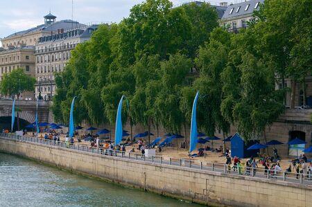 Summer beach in Paris at the river Editorial