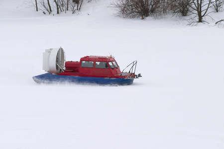 rescue service: Rescue Service snowmobile patrol on duty in winter on frozen river Stock Photo