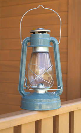 Retro oil kerosene lantern on country house fence closeup Stock Photo - 10343040