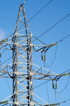 High-voltage power line metal tower vertical view photo