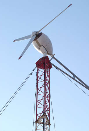 Single wind power generator on long tower vertical photo