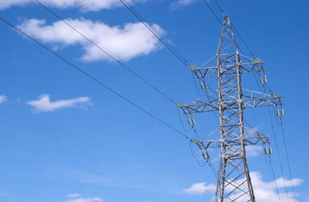 isolators: Metal prop and high-voltage power line over blue sky