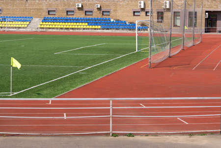 Part of sport stadium with sits football field and gates photo