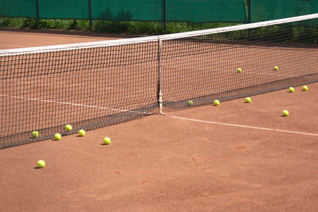 Tennis court and yellow ball before net photo