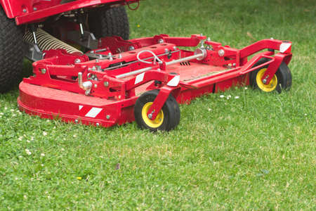 Lawnmower cuts a green lawn  photo