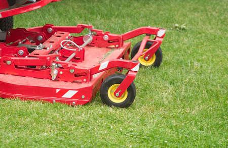 Lawnmower cuts a green lawn  closeup photo