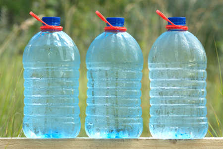 water can: Three plastic cans with cold ecologically pure drinking water