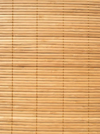 Brown straw mat background vertical view closeup photo