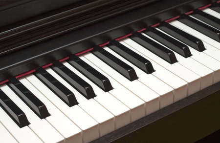 Digital electric piano keyboard closeup photo