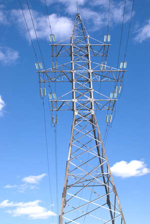 isolators: High-voltage power line metal tower over blue sky