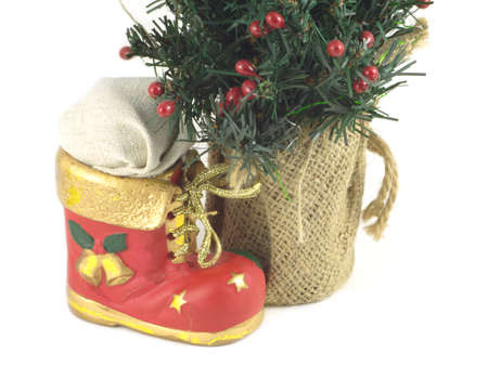 bootee: New Year tree and Red Christmas toy bootee isolated on white closeup