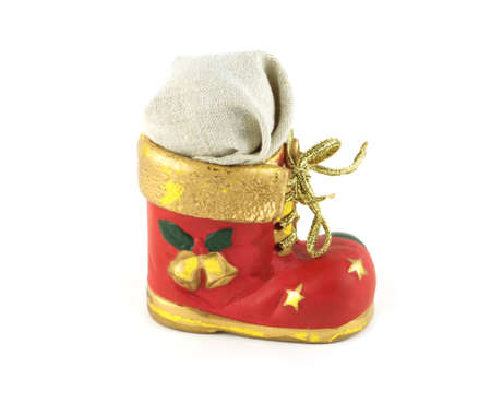 Red Christmas toy bootee with gift isolated on white photo