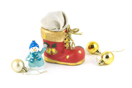 bootee: Red Christmas toy bootee with gift funny snowman and cristmas balls isolated on white