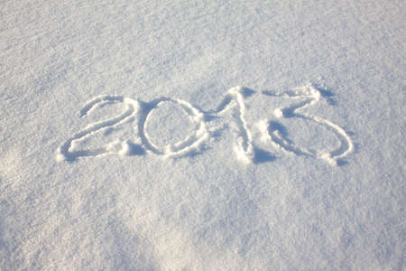 2013 inscription on  flat snow surface closeup photo