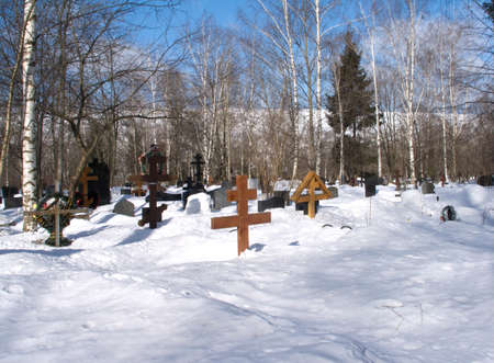 Winter landscape with suburban cemetery in deep snow photo
