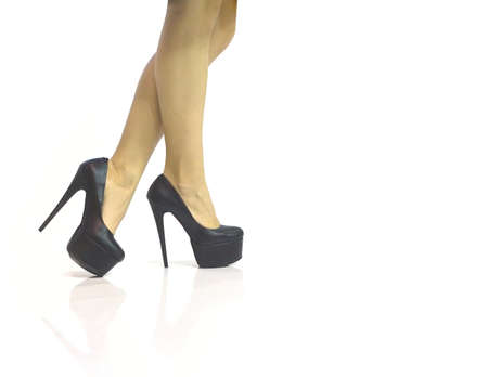 vouge: Sexy legs in black shoes with high heels isolated on white background Stock Photo