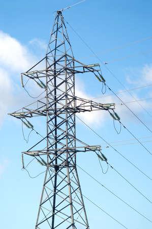 isolators: High-voltage power line metal tower prop over blue sky  Stock Photo